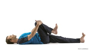 Yoga pose for lower back half knees to chest