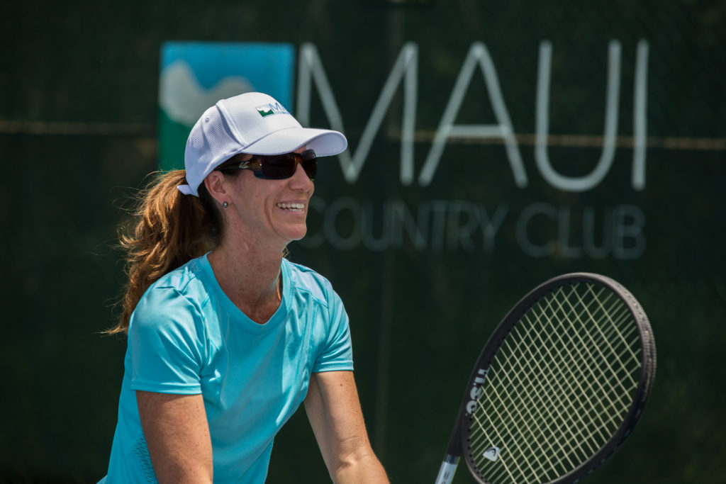 Teammate Dorien Romanchak awaiting a serve at Maui Country Club
