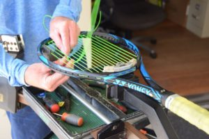 Maui Country Club's Tennis Pro Max Watson stringing a member racquet