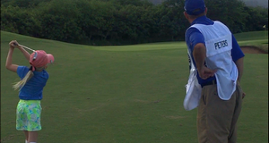 US Kids golfer with dad caddy at the Dunes Maui Lani golf course